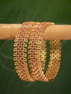 American diamond and ruby stones bangles. Ideal for sarees and other traditional costumes. American diamond and ruby stones bangles. Ideal for sarees and other traditional costumes. Gold Chain Design, Gold Bangles Design, Gold Earrings Designs, Gold Jewellery Design, Ruby Bangles, Bridal Bangles, Indian Gold Bangles, Gold Plated Bangles, Silver Bracelets