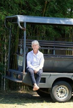 Doing battle: Bali resident Susi Johnston on a police car. Police have been deployed to protect her while her attackers ...