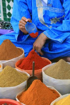Spices at a local market in Agadir, Morocco. Seen here, Paprika on the scoop with many other fragrant spices also on offer such as cumin, nutmeg, ground fennel seeds and ground cardamom.