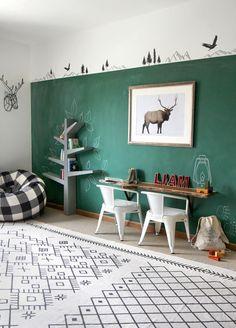 Green chalkboard wall in playroom