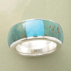 TURQUOISE WINDOWPANE RING  Item No. 35410$120.00 Open up your look with this blue turquoise windowpane ring's vibrant hues.  A blue turquoise windowpane ring, with a window of bright blue turquoise flanked by soft green turquoise inlaid on a band of polished sterling silver. Color of stones may vary. Exclusive. Whole sizes 5 to 9.