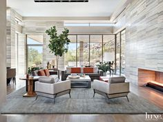 In the living room of this Scottsdale home, designer David Michael Miller and architect C.P. Drewett clad the walls in Italian travertine from Stockett Tile & Granite Company. The Randolph sofas and Pocket lounge chairs are all from Coraggio in Los Angeles, and the Holly Hunt coffee table is from John Brooks Incorporated.