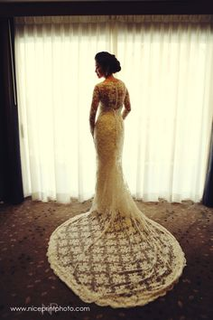 Long Sleeve Lace Wedding Gown with Train | http://brideandbreakfast.ph/2014/07/22/laced-with-luxe/ | Photographer: Nice Print Photography