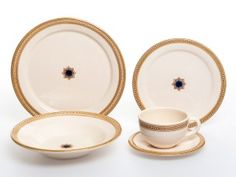 This fine Italian dinnerware set is handmade by Francesco Fasano, one of the most celebrated artists in Grottaglie.