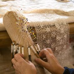 Lace aka Bizzilla    Lace making is a very old tradition in the Maltese islands; Gozitans are particularly famous for it. We are speaking about the real hand-made stuff (bobbin lace) - machine-woven lace pales in comparison. Unfortunately it is a dying crafts, as it involves long hours of intricate work, and the income most of the time does not justify it. Here you can see the skillful hands of an expert Gozitan lace maker working with silk. In the background you can see a good example of a…