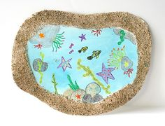 Tide Pool Art Project using real sand! (Perfect for an ocean or sea life unit and is adaptable for toddlers, preschoolers, kindergarteners, and up!) ~ BuggyandBuddy.com via @https://www.pinterest.com/cmarashian/boards/