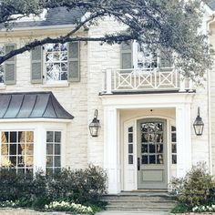Love this house for French home design decor inspiration ideas. White stone brick house with a green front door, green shutters, and black lantern sconces as exterior light fixtures on the front porch House Design, House, House Exterior, House Styles, Exterior Brick, Exterior Design, New Homes, Colonial House, House Paint Exterior