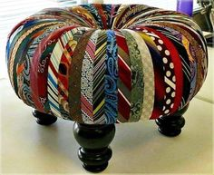 Ottoman made from old neckties. A great gift for dad when he retires and doesn't need all those ties anymore.
