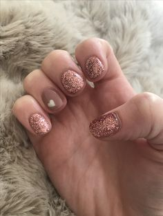 Rose gold and heart nail art design