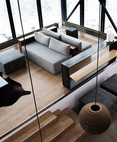 Using couches as a way to separate spaces in a room is so innovative!