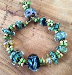 Adjustable lamp work bracelet on hand-dyed silk cod https://www.etsy.com/listing/206751450/koyglass-adjustable-lampwork-bracelet-on?ref=shop_home_active_3 #keyshakoy #keyshakoyglass #glass #blownglass #handmade #handmadejewelry #jewelry #bracelet #hippie #hippiestyle #boho #coachella