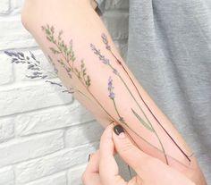 lavender tattoo on arm by rit kit, plant tattoo
