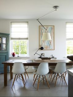 White eames shell chairs with rustic table  This combination never gets boring to me - the wood table with white chairs. Love the lighting as well.