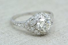 RESERVED!!! Payment 1-of-5 1.25 Carat Old Mine Cut Diamond in an Edwardian / Art Deco Platinum Engagement Ring with Diamond Ribbon Halo