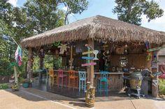 "Tropical Bar with Custom Painted Maaya Home Napoleon 29"" Barstool, Built-in bookshelf, Pendant Light, limestone tile floors"