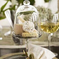 How fantastic....personal cheese and cracker place settings under a cloche!
