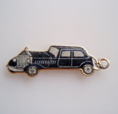 Hey, I found this really awesome Etsy listing at https://www.etsy.com/uk/listing/225085783/9ct-gold-stretch-limousine-enamel-charm