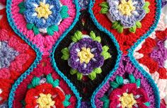 Free crochet pattern for a floral boho tile with halves and quarter pieces for squaring off. PLUS how to calculate number of tiles needed.