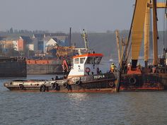 Tug boat at work just outside the entrance to Chatham docks [shared]