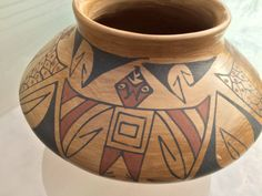 This is a handmade pottery vessel made by Elda Hernandez of Mata Ortiz. It features four large thunderbirds with their wings outstretched, as