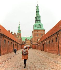 Exploring Frederiksborg Castle near Copenhagen, Denmark on a winter day. Visiting castles is one of the best day trips from Copenhagen in the winter!