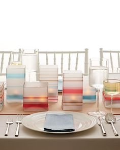 Modern-Day Luminaria Centerpieces  Use our clip art to make these modern luminarias. Download our striped design, print it onto vellum, and wrap it around square glass vessels.