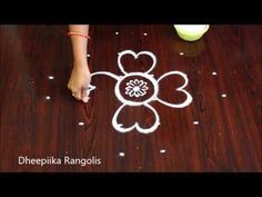 Rangoli it is our Indian tradition to draw rangoli every day morning in front of the house Rangoli special main theme is different type of rangoli designs ju. Rangoli Designs Flower, Small Rangoli Design, Rangoli Border Designs, Beautiful Rangoli Designs, Rangoli Borders, Muggulu Design, Rangoli With Dots, Main Theme, Simple Rangoli