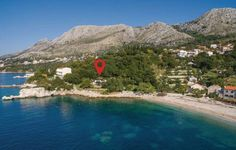 Holiday Home Dubrovnik with Sea View 11 Dubrovnik Holiday Home Dubrovnik with Sea View 11 is a studio set in Mlini, 10 km from Dubrovnik. The property boasts views of the sea and is 2.9 km from Cavtat. Free WiFi is provided throughout the property.
