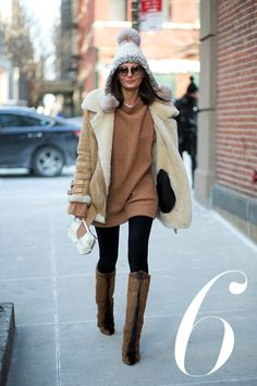 Where: On the street Why: There's no such thing as too much fur for Battaglia, who braved the cold with a shearling coat and equally fuzzy knee-high boots. - HarpersBAZAAR.com