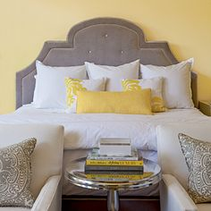 Sophisticated Refuge                                       A bold gray-and-yellow combo makes a statement in this guest room. The bold contrast is softened with soft fabrics and textures                                         like the velvet-covered headboard.