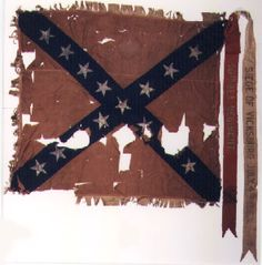 The second flag of the 40th Alabama Infantry replaced the very first that had been presented to the regiment on September 9, 1862, during the early years of the Civil War.  This first flag was captured at the fall of Vicksburg, but while at Vicksburg the regiment received a second flag, shown here, which was not captured and was hidden to prevent its capture and remained with the regiment until they received a new Hardee pattern flag at Demopolis, Alabama in October 1863.