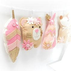 *BRAND NEW* A twist on our popular tribal garland!  Prettied up with flowers and in a gorgeous pink. blush, gingerbread and gold colouway.  Items are roughly 12cm tall.  Handstitched and lightly stuffed.  Each item is threaded onto ribbon to make a gorgeous garland. Please allow