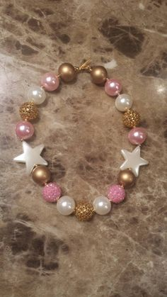 Check out this item in my Etsy shop https://www.etsy.com/listing/237598670/sale-ready-to-ship-pink-gold-ivory-star