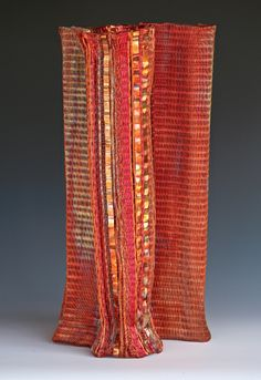 Frances Solar   FSolar-Vessel 6. Loom woven, copper wire, heat patina.