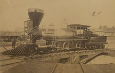 """United States Military Railroad 4-6-0 steam locomotive """"E.M Stanton"""" on the turntable, Alexandria, Virginia, 1864. The locomotive was named for Edwin McMasters Stanton who was Secretary of War for most of the Civil War."""