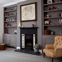 Grey traditional living room with fireplace and alcove shelving is part of Living Room Shelves Offices - Decorate your living room in a palette of deep greys for a cocooning effect Alcove Ideas Living Room, Living Room Shelves, Living Room Storage, Living Room With Fireplace, Living Room Grey, Home Living Room, Living Room Designs, Room Ideas, Built In Cupboards Living Room