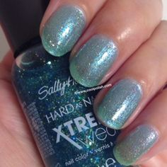 """Sally Hansen's """"Sea-ing Stars"""" is a light (probably topcoat) glitter with small holo-glitter and flecks of micro-glitter. Will probably look great over white. Or something."""