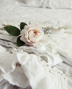 rose on white linen...