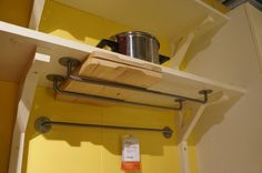 Great storage idea for cutting boards or baking sheets using $2.99 rails from Ikea.: