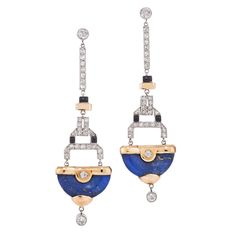 Art Deco Lapis Lazuli Diamond Gold Platinum Pendant Earrings. Old European and single cut diamonds totaling approximately 1.50 carats accented by black enamel suspend lapis semicircles in a platinum and 18 karat yellow gold mounting. The earrings measure 2-3/4 inches in length and are 3/4 inch at the widest point. c 1925