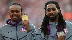 Silver medallist Jason Richardson (R) of the United States and gold medallist Aries Merritt (L) of the United States pose on the podium during the Medal Ceremony for the men's 110m Hurdles on Day 13 of the London 2012 Olympic Games at the Olympic Stadium.