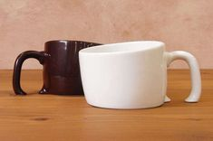 Treasure Mug - Slowly burying itself into your table, the Treasure Mug looks as though it has started to melt. The slight tilt to the base as well as the handle t...