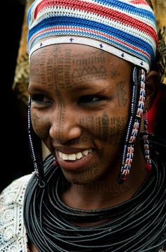 Africa | Portrait of a beautiful Peul ( Fula,Fulani) woman. The Peul decorate their faces with beautiful tattoos.  Photo taken in Northern Benin.