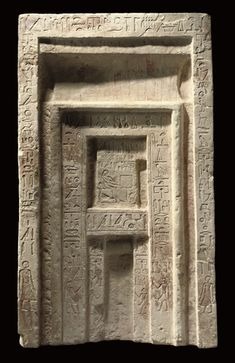 AN EGYPTIAN PAINTED LIMESTONE FALSE DOOR OF THE INSPECTOR OF THE SCRIBES OF THE TREASURY, DJATY OLD KINGDOM, LATE DYNASTY VI, CIRCA 2283-2184 B.C.