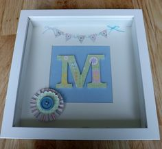 Name picture with paper craft pinwheel and button decoration. Handmade by Bev Hobbs.