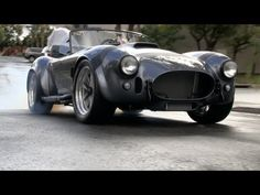 """Classics Revealed: The Shelby Cobra  The Shelby Cobra is perhaps the World's most iconic and thus copied car. Less than 1000 original Ford AC Cobras were built by Carroll Shelby. Tens of Thousands of copies. In this exclusive TFLcar video we visit Superformace in Southern California to learn why the Shelby Cobra is such an iconic race car and automobile. Superformance along with Carroll Shelby's own Shelby Automobiles, Inc build what many call """"Continuation Cars""""."""