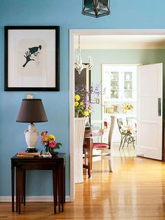 Vivid blue frames the rest of this home and provides a background for glam black-and-white accessories. Make it work for you: -- Lighten up a strong cool hue with bright white trim. -- Choose contrasting accent colors to give the wall color an edge. -- If your rooms open into one another, choose a different shade of the same color for the paint.