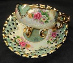 SHAFFORD JAPAN PINK ROSES 3-FOOTED LUSTER GREEN TEA CUP AND SAUCER