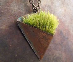 """Living jewelry"" this unique pendant is a little copper planter with real moss growing in it."