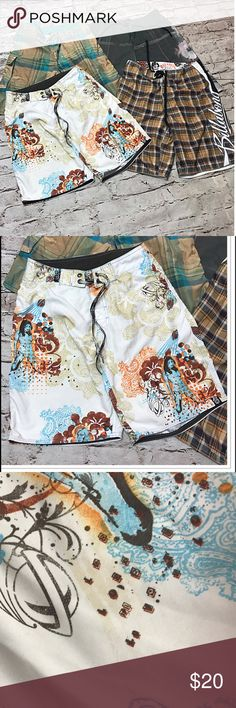 MEN'S SZ 30 LOST BRAND SWIM/BOARD SHORTS Great pair of white board/Swim trunks with a couple of vague spots on the back. See pics. All trunks are available in a separate listing with detailed pics of each. This is for 1 pair only. They are not lined Lost Swim Board Shorts